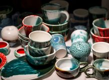 Colorful painted and glazed craft pottery ranges Stock Images