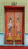 Colorful painted gods on gate of Buddhist church Stock Image