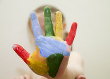 Colorful painted hand. Of a young girl Stock Photos