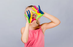 Colorful painted hands in a beautiful young girl. Royalty Free Stock Photo