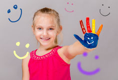 Colorful painted hands in a beautiful young girl. Stock Photo