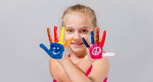 Colorful painted hands in a beautiful young girl. Stock Photography