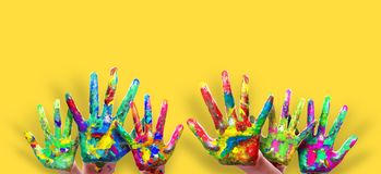 Colorful Painted Hands. Painted hands, colorful fun. Creative, funny abstract and artistic means happiness. Isolated on yellow stock image