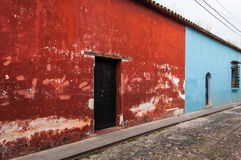 Colorful painted houses in Antigua, Guatemala. Typical painted colonial style houses in UNESCO World Heritage Site, Antigua, Guatemala royalty free stock photography
