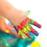 Colorful painted infant hand. Royalty Free Stock Photography