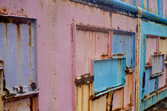 Colorful painted iron rusting over time Royalty Free Stock Photo