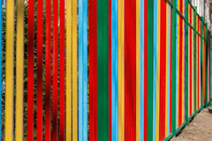 Colorful painted metal fence on sunny day Stock Photography