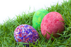 Colorful painted three easter eggs. On the grass Stock Photos