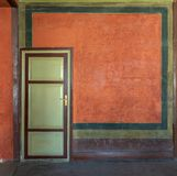 Colorful painted wall and green wooden door, Cairo, Egypt. Colorful painted wall and green wooden door at the historic building of Mevlevi Tekke, Cairo, Egypt Royalty Free Stock Image