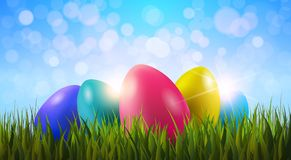 Colorful Painter Easter Eggs In Green Grass Over Blue Boker Blurred Sky Background. Vector Illustration Stock Photo