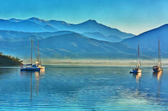 Colorful painting of anchored yachts at misty morning Stock Photo