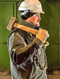 Colorful painting of tough worker in helmet. And  sledgehammer Stock Photography