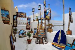 Colorful paintings for sale. A lot of colorful sea pictures  for sale in a village in Santorini, Greece Royalty Free Stock Images