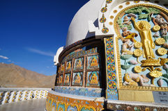 Colorful paintings on the wall of buddhist stupa with himalayas Stock Photography