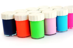 Colorful paints. Colorful paint bottles isolated on white background Stock Photography
