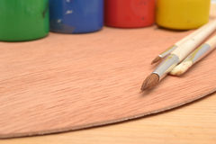Colorful paints and brushes Stock Images