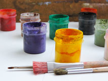 Colorful paints and brushes  Stock Image