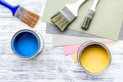 Colorful paints and brushes on grey wooden desk background top view copyspace Royalty Free Stock Photos