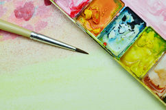 Colorful paints and brushes Royalty Free Stock Image