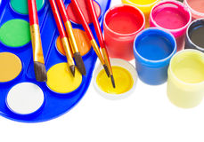 Colorful paints and brushes Royalty Free Stock Photography