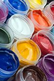 Colorful Paints. Closeup of opened jairs of gouache paints Royalty Free Stock Photos