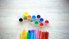 Colorful paints and felt-tip pens lying on table, early development school. Stock photo royalty free stock image