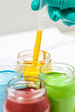 Colorful paints in jars Royalty Free Stock Image
