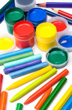 Colorful paints and pencils Royalty Free Stock Images