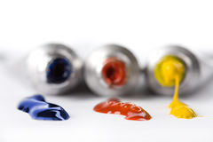 Colorful paints squeezed from tubes Royalty Free Stock Photos
