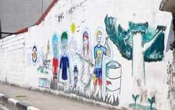 Colorful paints and street art line the walls. MANILA, PHILIPPINES -11 JANUARY 2015. Colorful paints and street art line the walls and back alleys of the Royalty Free Stock Images