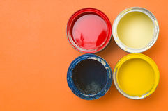 Colorful paints in tins Stock Photo