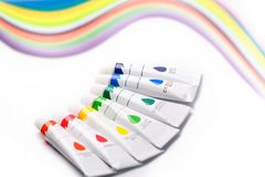 Colorful paints in tubes for drawing, rainbow. Gouache for creativity Stock Photo