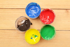 Colorful paints on wood Stock Image