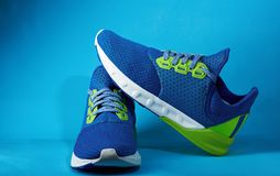 Colorful jogging shoes. Colorful pair jogging shoes isolated on blue background. Sport sneakers for gym exercise Royalty Free Stock Photo