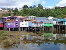 Colorful palafotos houses on woodel columns in chiloe island stock photography