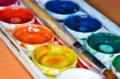 Colorful palette with watercolors and paint brushes Stock Image