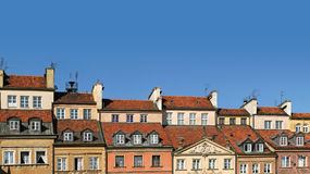 Colorful panorama of rooftops of old townhouses. Panoramic view of rooftops of historic townhouses on Warsaw's Old Town Market Square Stock Photos