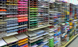 Colorful paper. Colorful scrapbook paper arranged on racks stock images