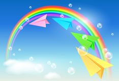 Colorful paper airplane and rainbow Royalty Free Stock Image
