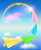 Colorful paper airplane and rainbow Stock Photo