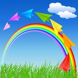 Colorful paper airplane and rainbow Stock Photos