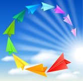 Colorful paper airplanes. Flying round in the sky Stock Image