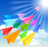 Colorful paper airplanes. Flying in the sky Stock Image