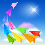 Colorful paper airplanes. Flying in the sky Stock Images