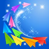 Colorful paper airplanes and glowing stars Royalty Free Stock Photo