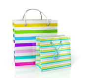Colorful paper bags for shopping. On a white background stock illustration