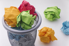 Colorful paper balls in a trash can Royalty Free Stock Photo