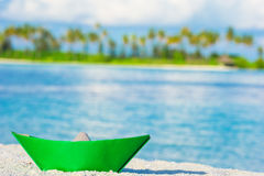 Colorful paper boat on tropical white beach Royalty Free Stock Photography