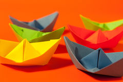 Colorful paper boats Stock Photos