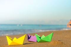 Colorful paper boats at the seashore Royalty Free Stock Photo
